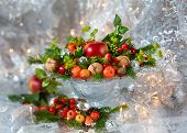 Christmas table decoration with fruit, nuts, fir branches