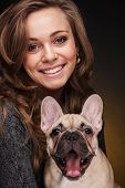 Beautiful girl with french bulldog puppy