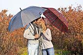 Couple kissing under umbrellas in the autumn park. Autumn set.