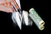 image of crack cocaine  - Cocaine and money on black mirror background  - JPG