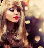 Blonde Hair. Blond. Beautiful Girl Portrait. Beauty Woman Portrait. Holiday Golden Blinking background. Party Make up