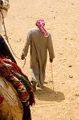 Man With His Camel