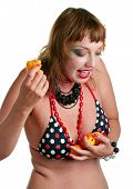 Woman In Bathing Suit Eating Apricots