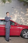 Businessman Tossing His Car Keys into the Air