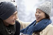 image of snowball-fight  - Young Couple Having a Snowball Fight - JPG
