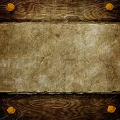 Old paper sheet on wooden background with space for your text or image