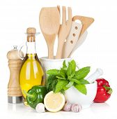 Fresh ripe vegetables, condiments and kitchen utensils. Isolated on white background