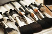 stock photo of cosmetic products  - Closeup of makeup tools in their holder - JPG