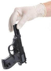 picture of sixgun  - Concept of a crime scene with Forensic police picking up a gun isolated on white - JPG