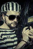 Weapon, Prison riot concept. Man holding a machine gun, prisoner