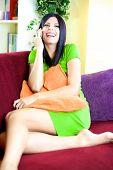 Beautiful Woman Having Fun Talking On The Phone At Home