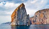 stock photo of messina  - The indented coastline of Lipari Island makes it very popular for the tourists and lonely rocks in sea are the visit cards of the island Aeolian islands Italy - JPG