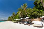 stock photo of boracay  - Sun umbrellas and beach chairs on tropical coast Philippines Boracay - JPG