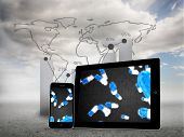 Falling pills on tablet and smartphone screens against global statistic on sky background