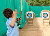stock photo of archery  - portrait of a child - JPG
