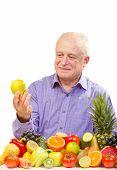 Senior man holding a green apple