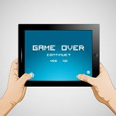 Hand holding gaming tablet