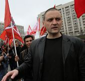 MOSCOW - MAY 1, 2011: Leader  of the Left Front movement Sergei Udaltsov in marsh leftist in the cen