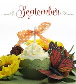 Beautiful Autumn Fall Theme Cupcake With Autumn Seasonal Flowers And Decorations For The Month Of Se