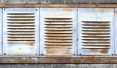 Background With Old Rusted Metal Ventilation Grille Panels