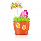 Flowerpot with grass and easter egg. Happy Easter concept.