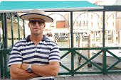 VENICE, ITALY - JUNE 12, 2011: portrait of gondolier on June 12, 2011 in Venice, Italy. Venice is a