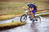 Cyclist At The Speed Of Moving Mountain River