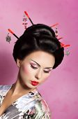pic of geisha  - Portrait of a Japanese geisha woman with flowers - JPG