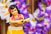 stock photo of figurines  - Tropical setting for a Hula girl doll - JPG