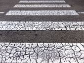 stock photo of zebra crossing  - Close view of a grunge pedestrian zebra crossing - JPG