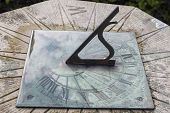 picture of sundial  - old vintage sundial in ireland after rain - JPG