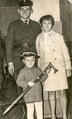 SIERADZ, POLAND, CIRCA FIFTIES - Vintage photo of parents with their little son