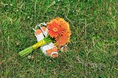 bridal bouquet and shoes on grass background