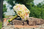 bridal bouquet on stone background
