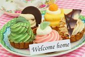 Welcome home card with colorful cream cakes