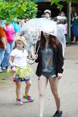 MUSKOGEE, OK - MAY 24: A young girl enjoys rainy weather at the Oklahoma 19th annual Renaissance Fes