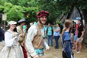 MUSKOGEE, OK - MAY 24: Actors dressed in historical outfits walk in the village parade during the Oklahoma 19th annual Renaissance Festival on May 24, 2014 at the Castle of Muskogee in Muskogee, OK.