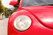 foto of beetle car  - Color detail on the headlight of a vintage modern car - JPG