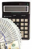 Dollars Banknotes And Calculator