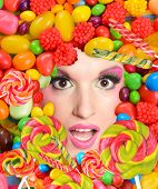 Woman beauty face with sweets frame, close-up