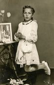 SIERADZ, POLAND, CIRCA SIXTIES - Vintage photo of girl at her First Communion