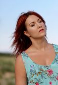 Redhead Girl With Closed Eyes Enjoying Summer Sunlight And Calm Wind
