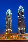 DUBAI, UAE - 3 APRIL 2014: The Al Kazim Towers in Dubai Media City at night. The Al Kazim Towers is a complex of two 53-floor towers, resemble to the New York City's Chrysler Building.