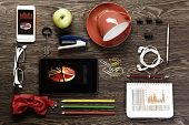 Office workplace with tablet cup mobile phone and stationary