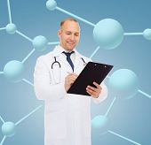 medicine, profession, biology, chemistry and healthcare concept - smiling male doctor with clipboard