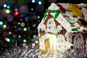 Homemade Gingerbread Christmas House With Night Bokeh Background