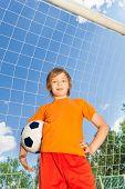 Portrait of boy in uniform with football