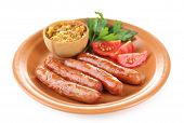 Tasty thin sausages on plate isolated on white