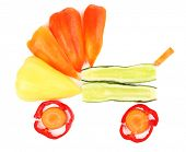 Fresh organic vegetables and fruits in shape of pram isolated on white