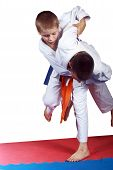 foto of judo  - Athlete with orange belt is doing judo throw - JPG